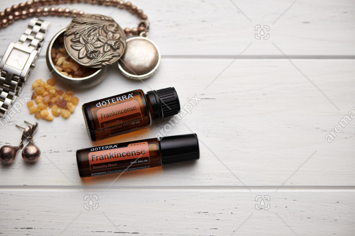 doTERRA Frankincense and Frankincense Touch on rustic background