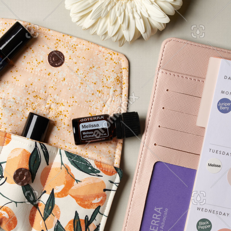doTERRA Melissa and business accessories on white