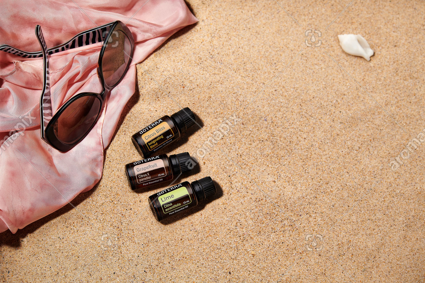 doTERRA Citrus Bliss, Grapefruit and Lime with accessories on sand