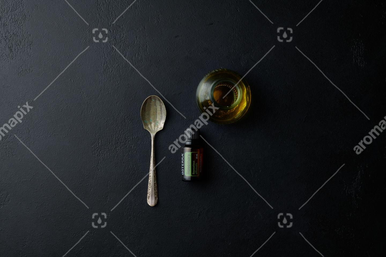 doTERRA Rosemary with utensils on black