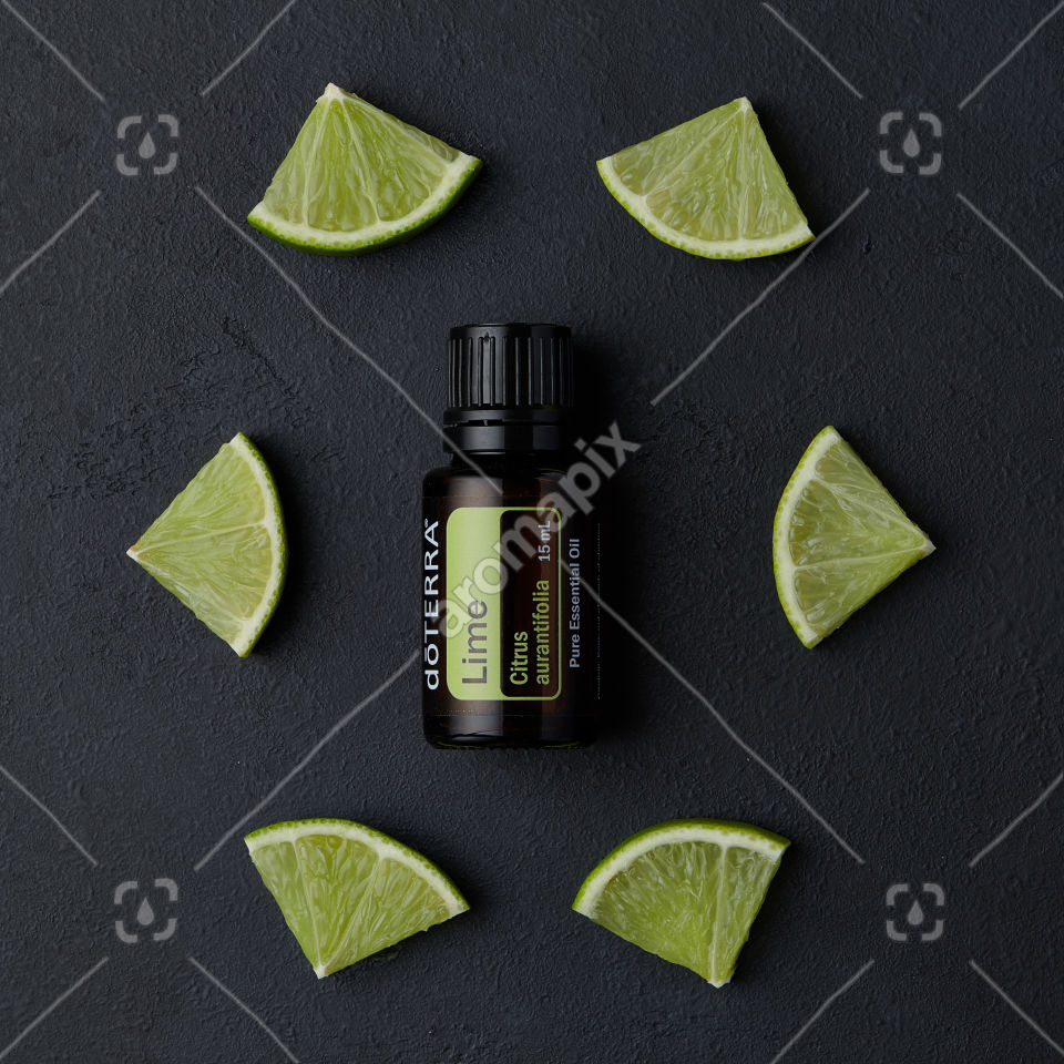 doTERRA Lime product and pieces on black background