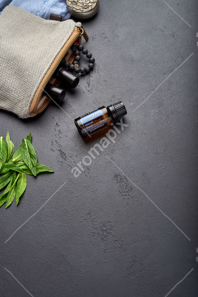 doTERRA DigestZen with mint leaves on black