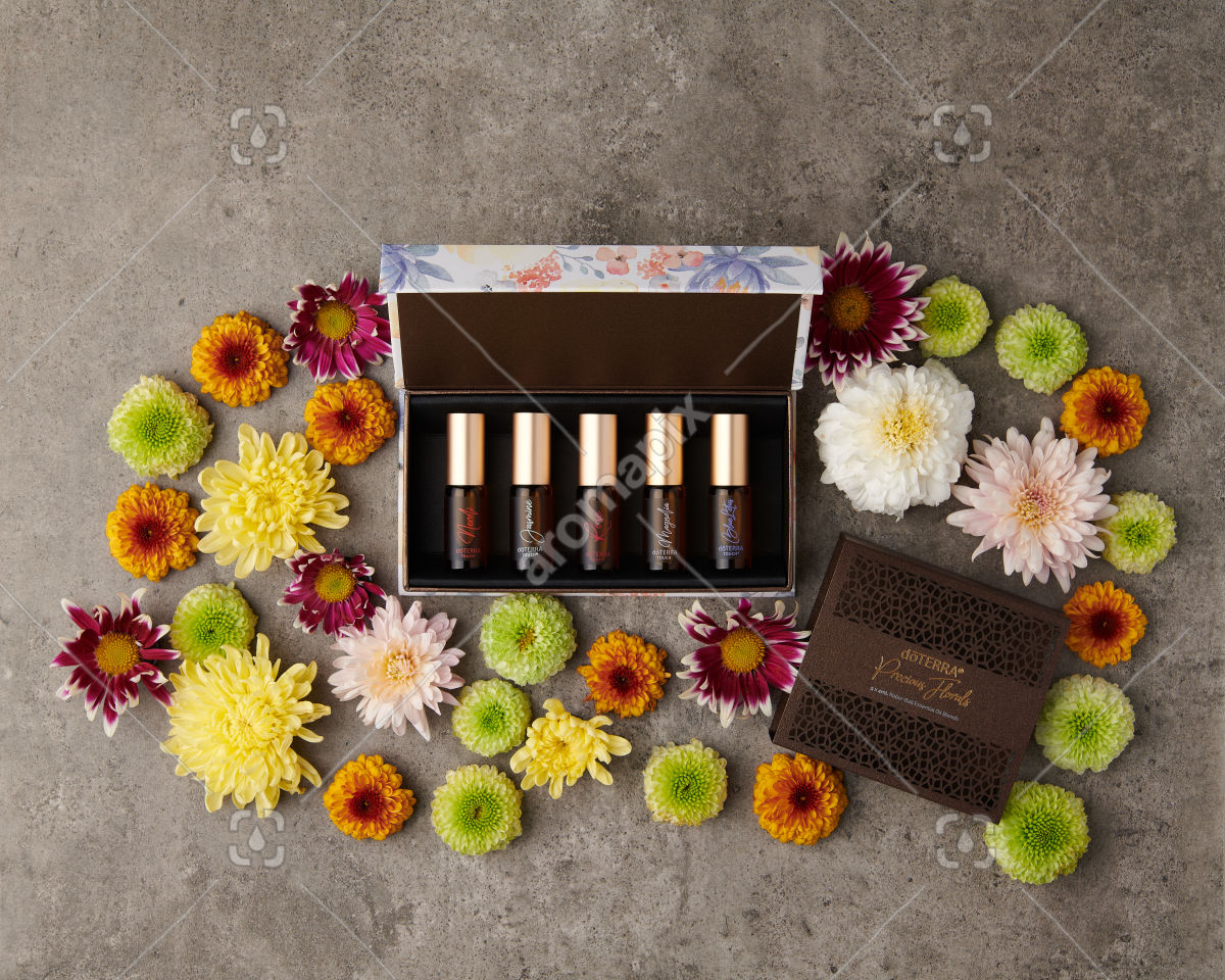 doTERRA Precious Florals Collection with scattered flowers