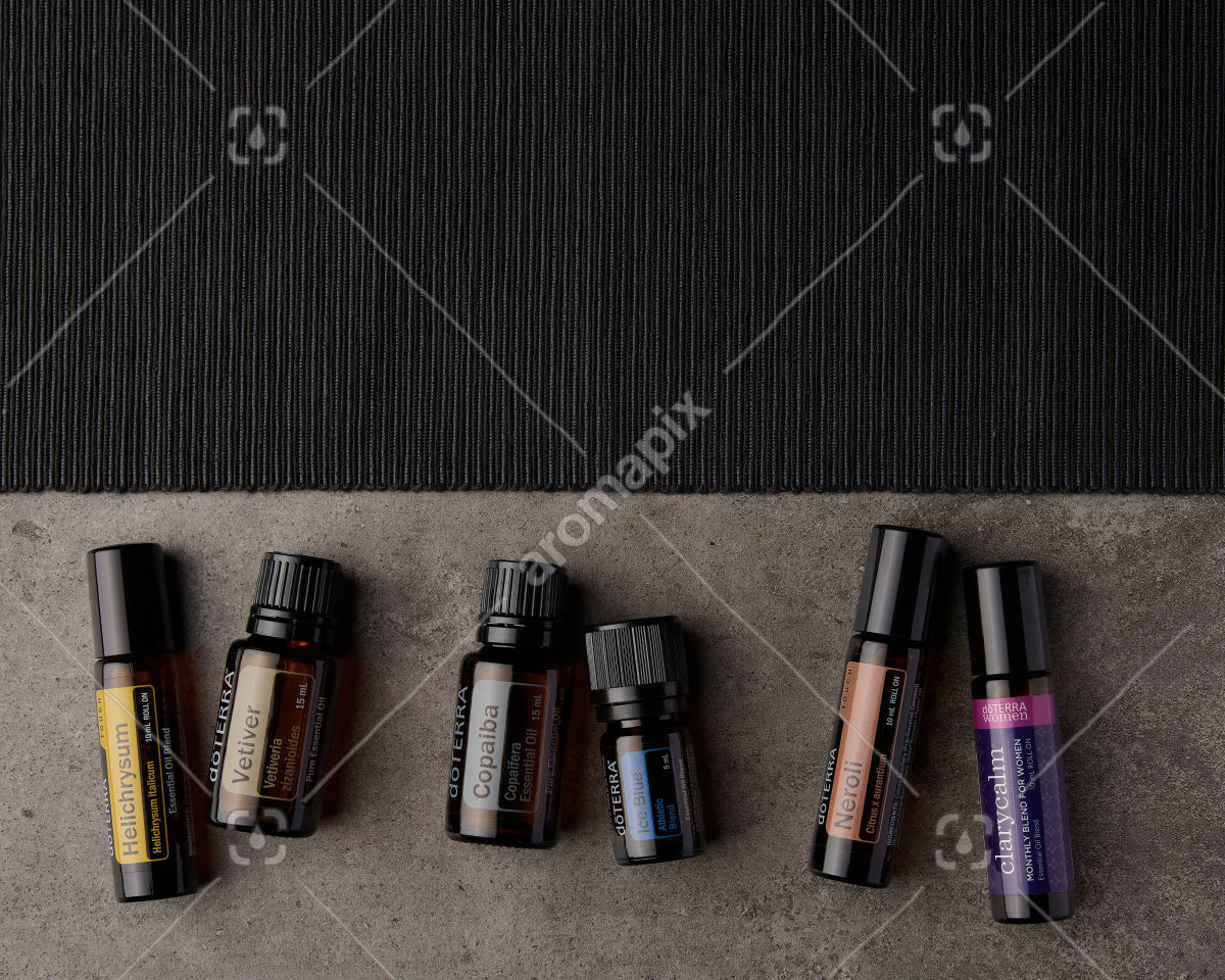 doTERRA Helichrysum Touch, Vetiver, Copaiba, Ice Blue, Neroli Touch and ClaryCalm on gray