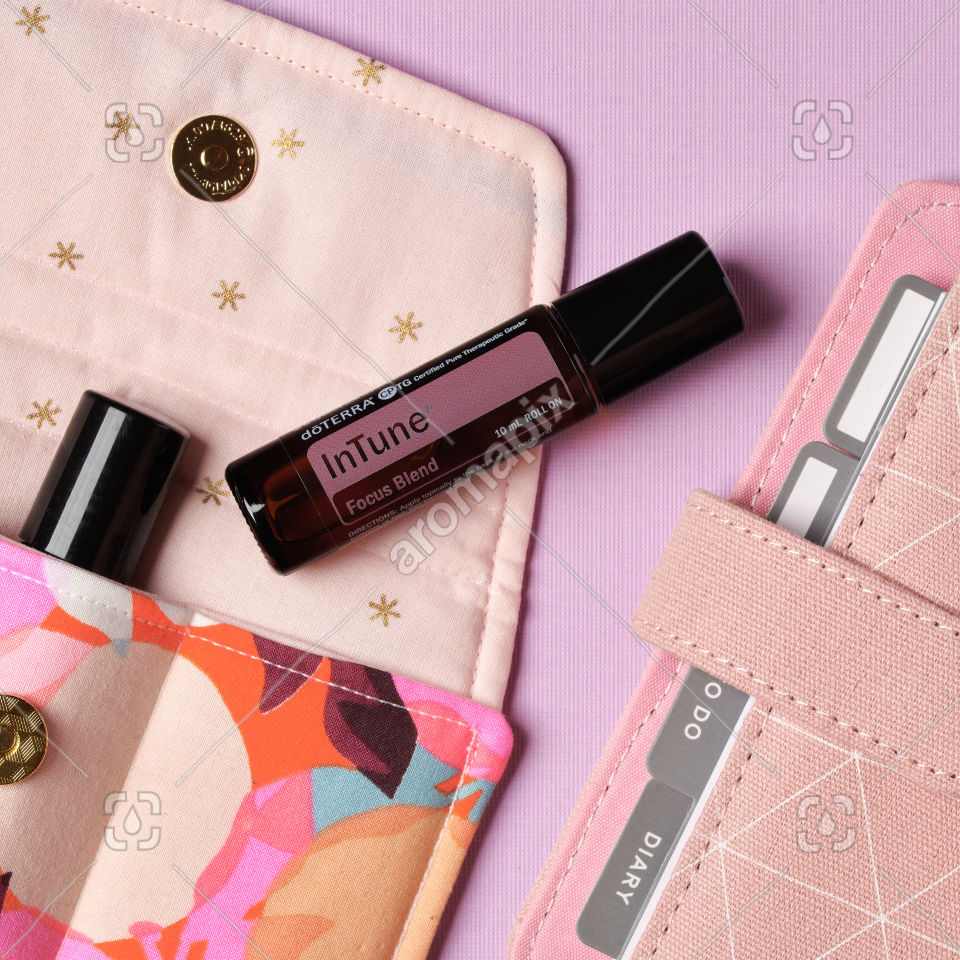doTERRA InTune Focus Blend and accessories on pale pink