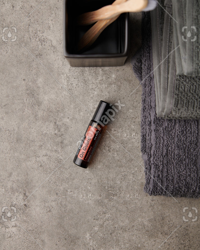 doTERRA On Guard Touch on a bathroom bench