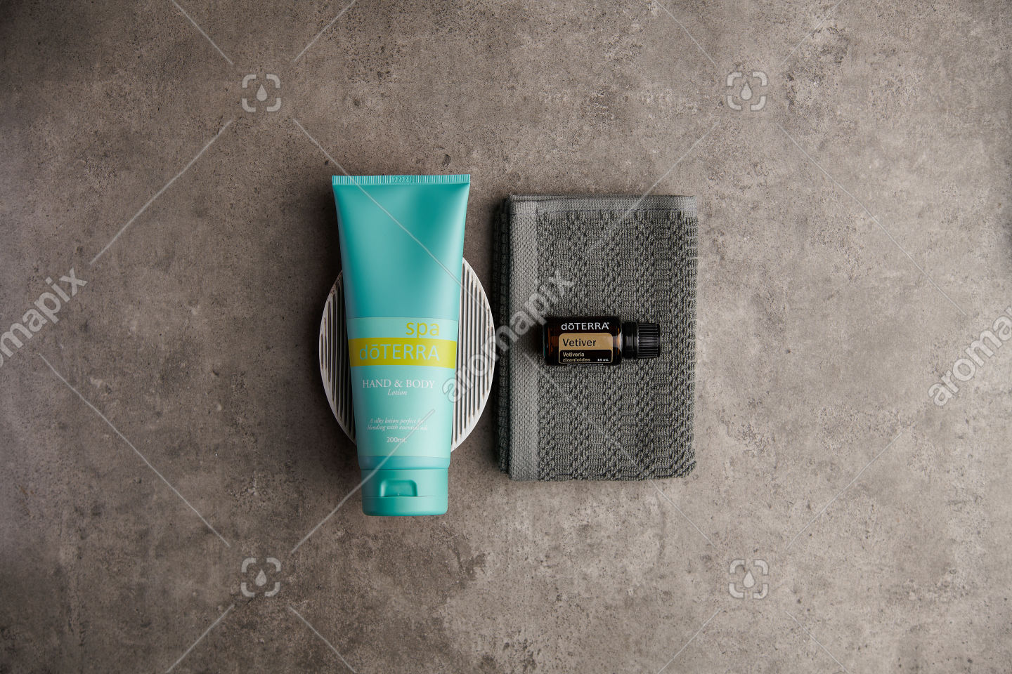 doTERRA Spa Hand and Body Lotion and Vetiver essential oil on stone