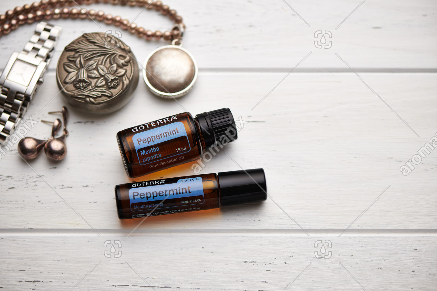 doTERRA Peppermint and Peppermint Touch on rustic background
