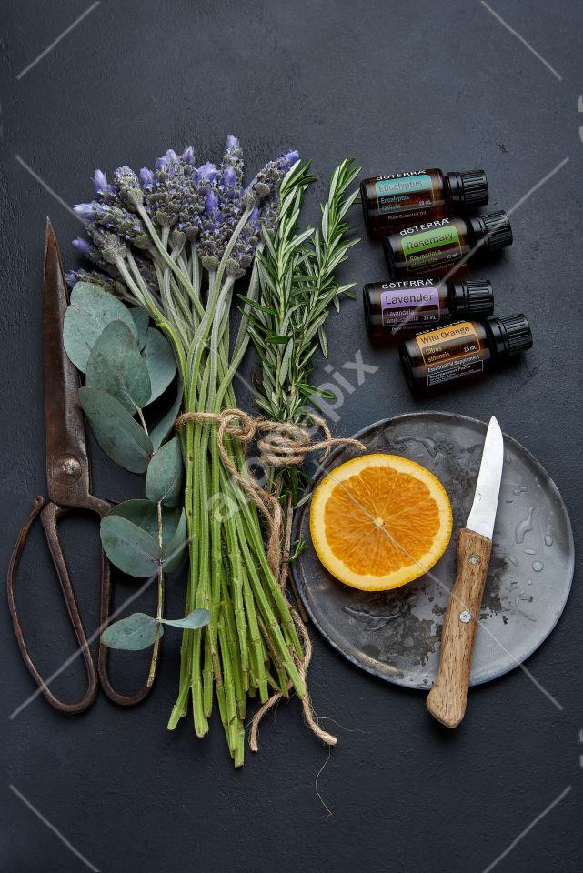 doTERRA Eucalyptus, Rosemary, Lavender and Wild Orange with ingredients on black