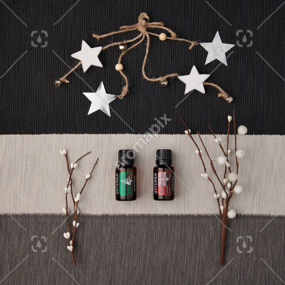 doTERRA Holiday Joy and Holiday Peace with decorations on a textured background.
