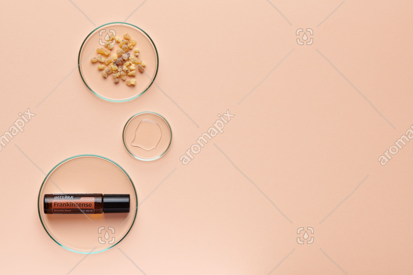 doTERRA Frankincense Touch with frankincense resin on pale orange