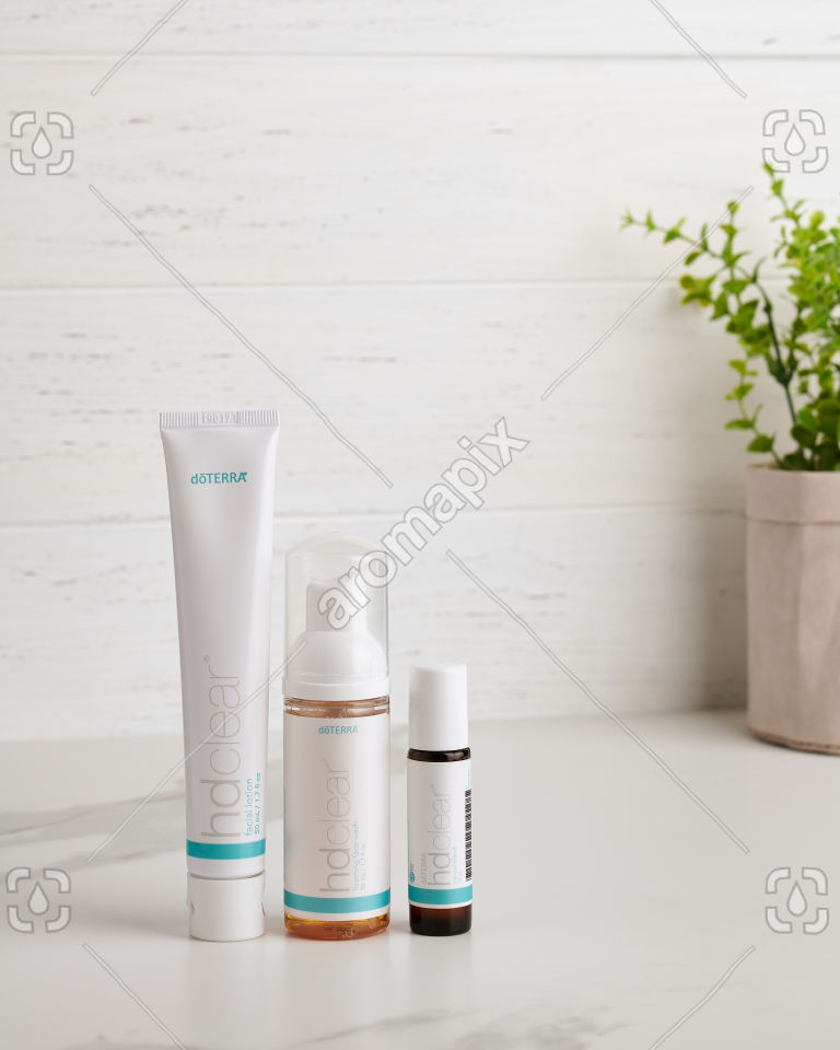 doTERRA HD Clear Facial Lotion, HD Clear Foaming Face Wash and HD Clear essential oil blend on white