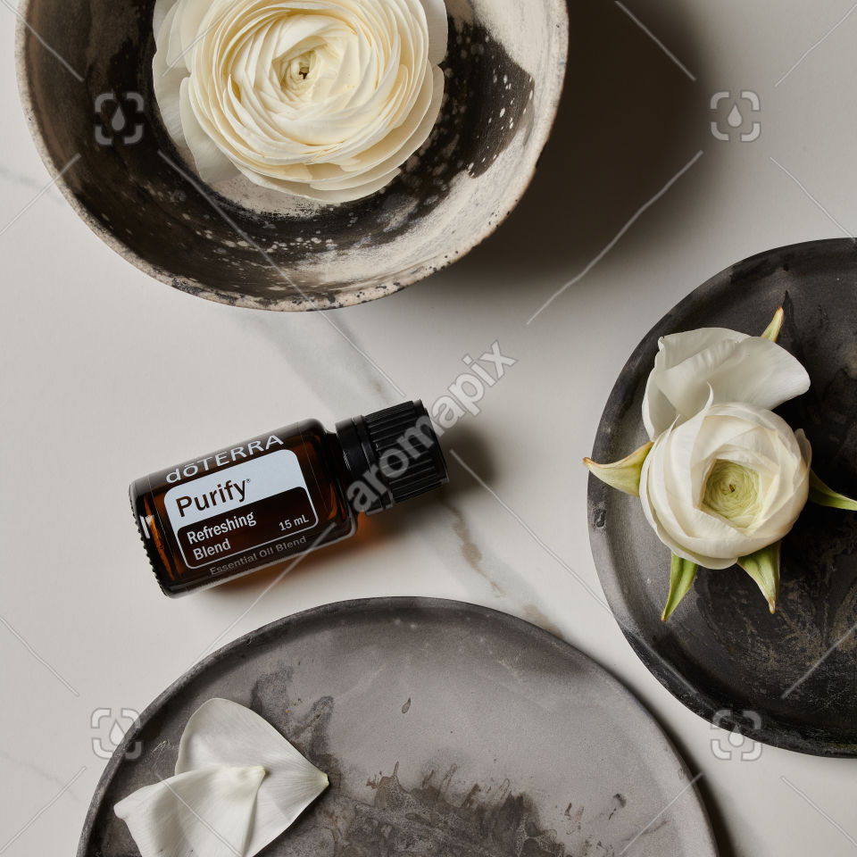 doTERRA Purify with flowers on gray