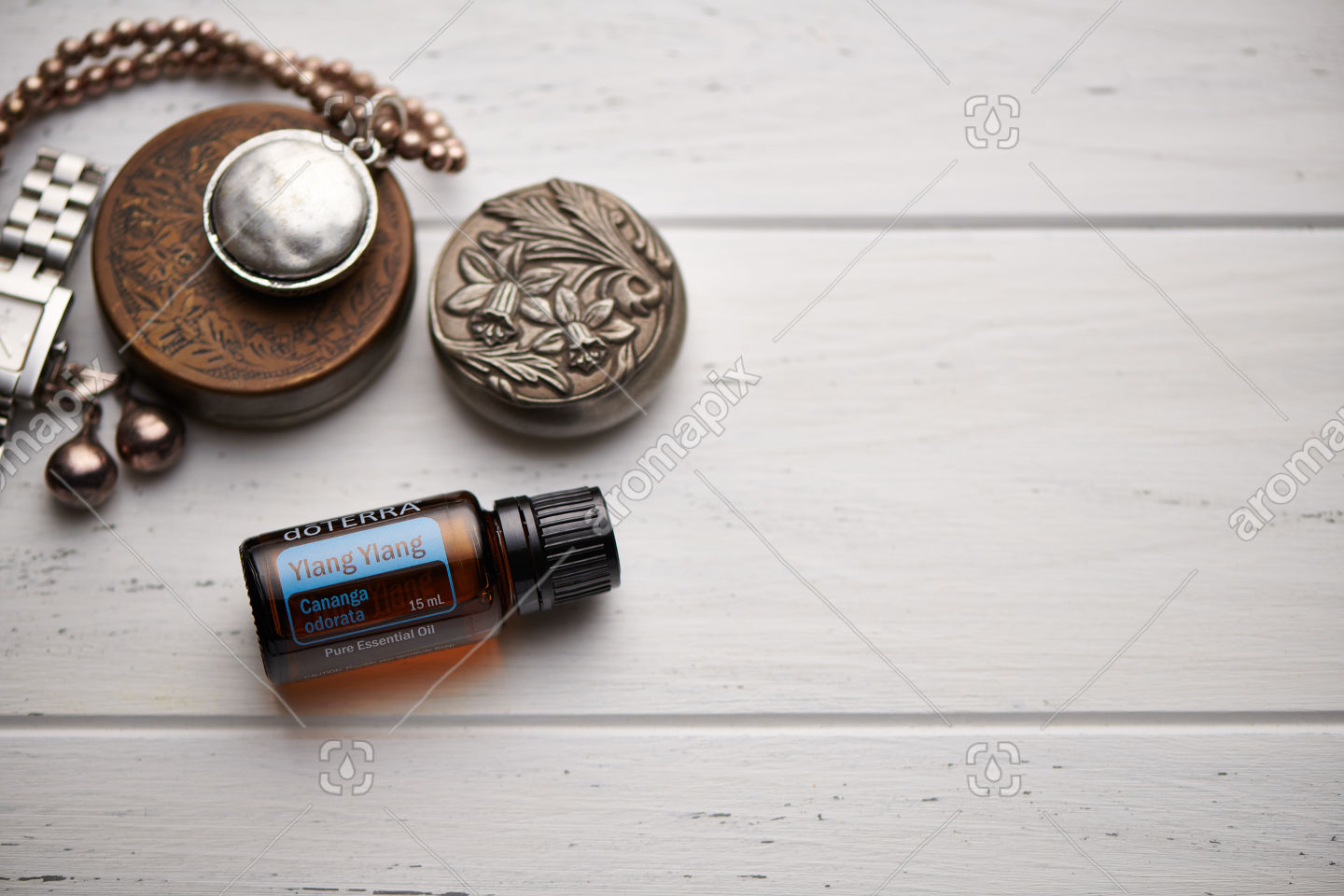 doTERRA Ylang Ylang on rustic background