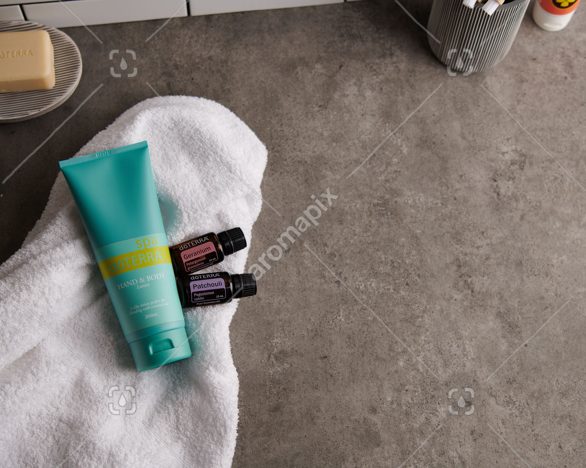 doTERRA Spa Hand and Body Lotion with Geranium and Patchouli essential oils on white