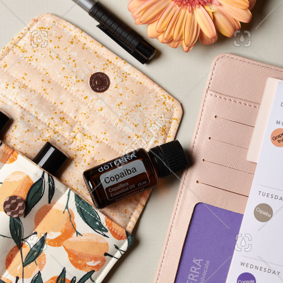 doTERRA Copaiba essential oil and accessories on white