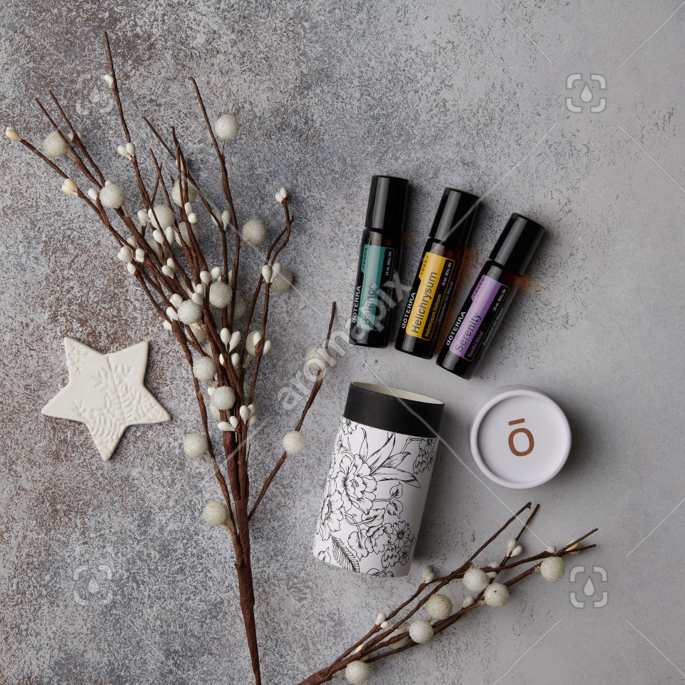 doTERRA Balance Touch, Helichrysum Touch, and Serenity Touch with a beautiful cylinder gift box on white