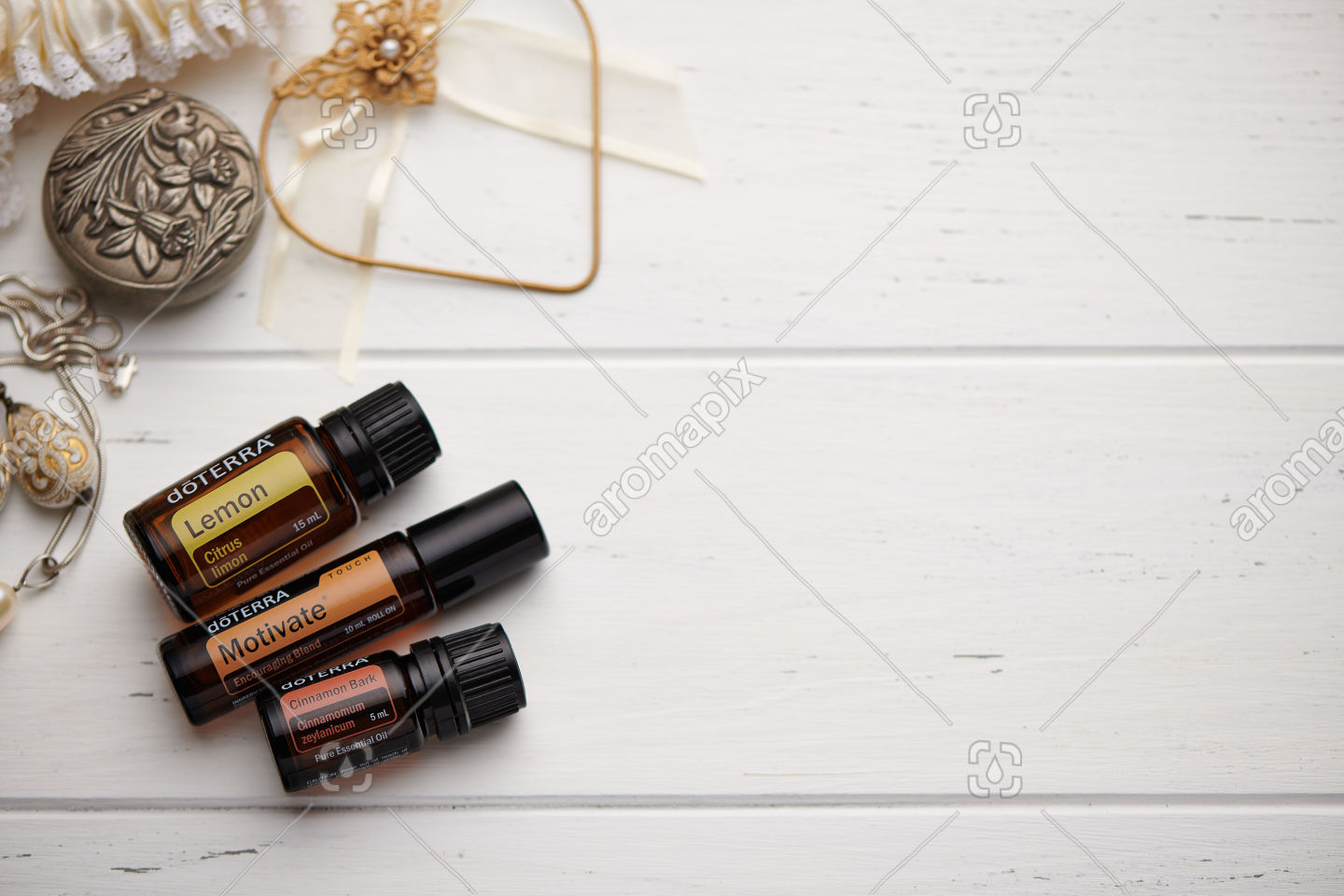 doTERRA Lemon, Motivate Touch and Cinnamon on white background