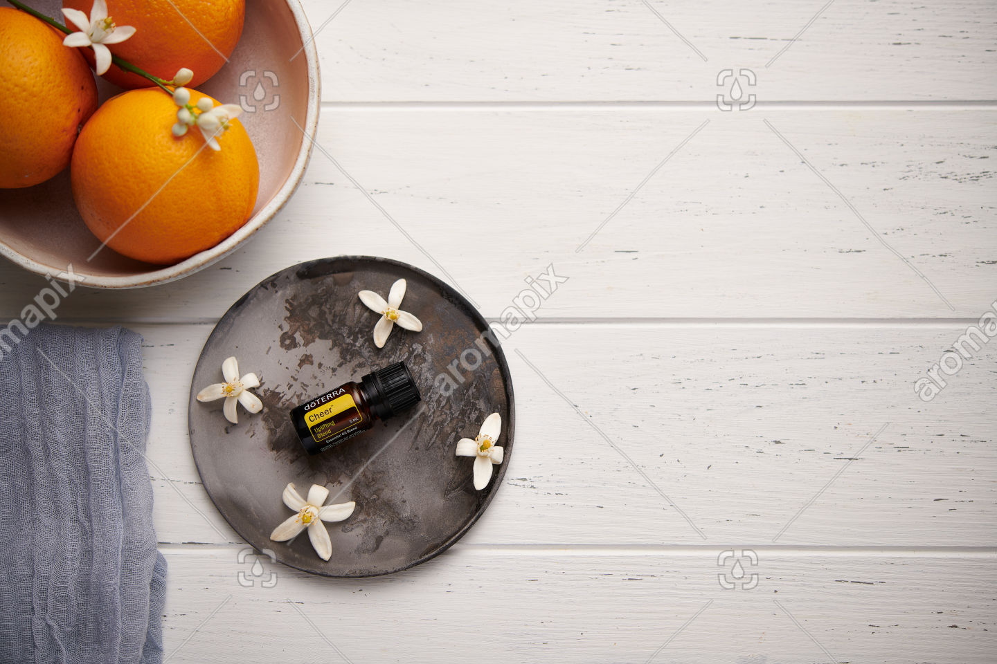 doTERRA Cheer with orange blossoms on white