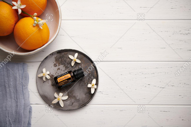doTERRA Citrus Bliss with orange blossoms on white