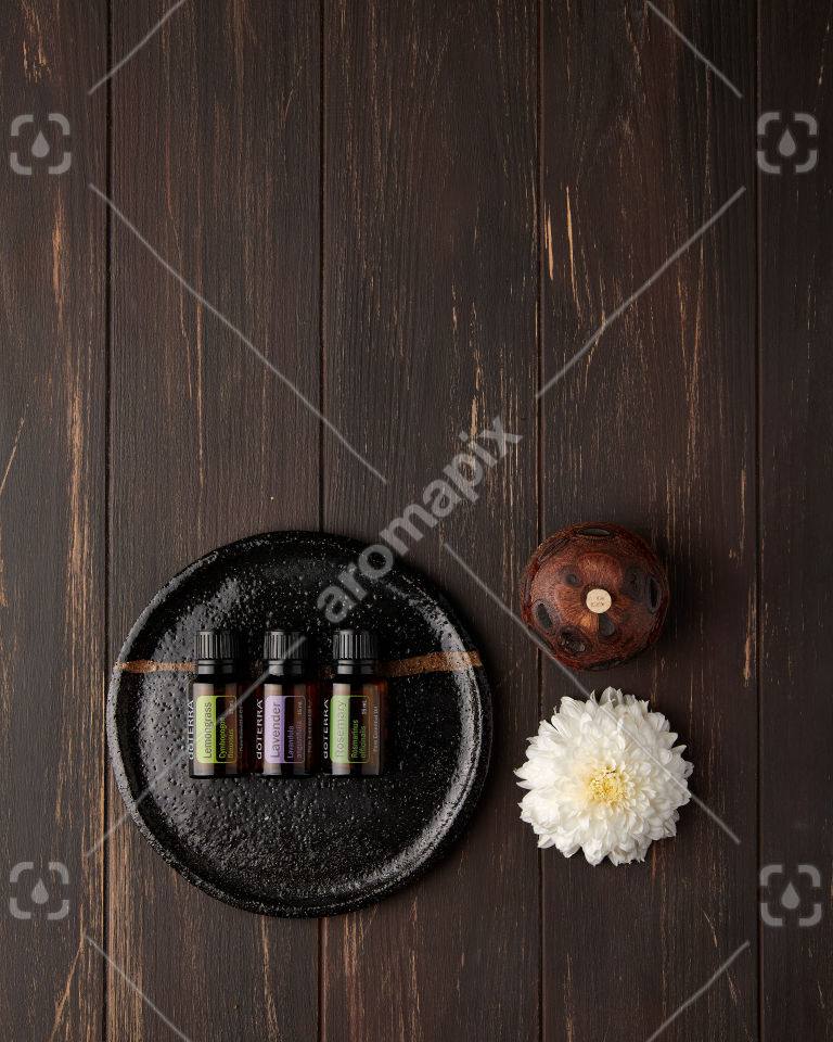 doTERRA Lemongrass, Lavender and Rosemary with accessories on rustic brown
