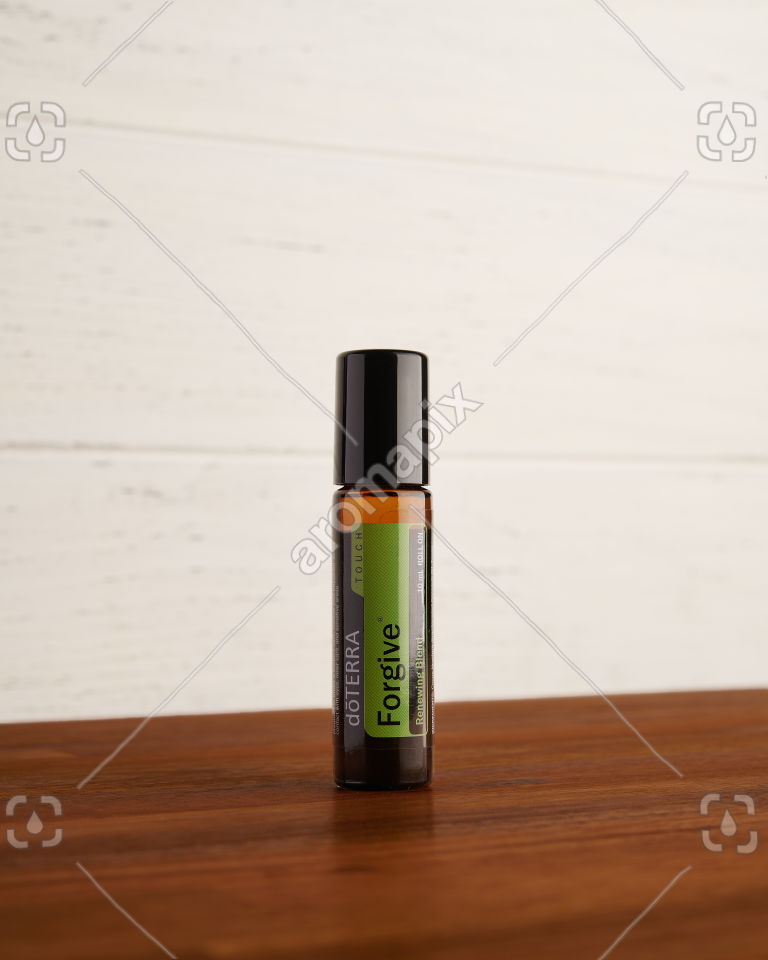 doTERRA Forgive Touch on a table