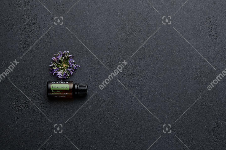 doTERRA Rosemary with rosemary flowers on black