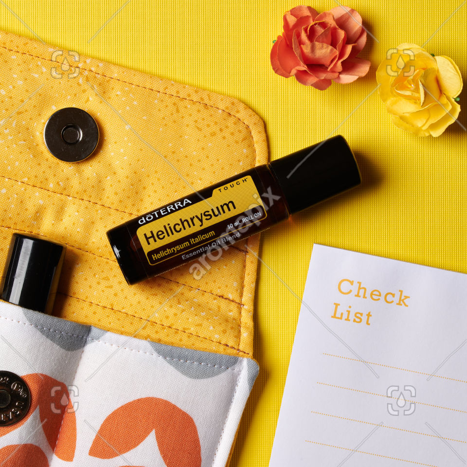 doTERRA Helichrysum Touch with flowers and accessories on yellow