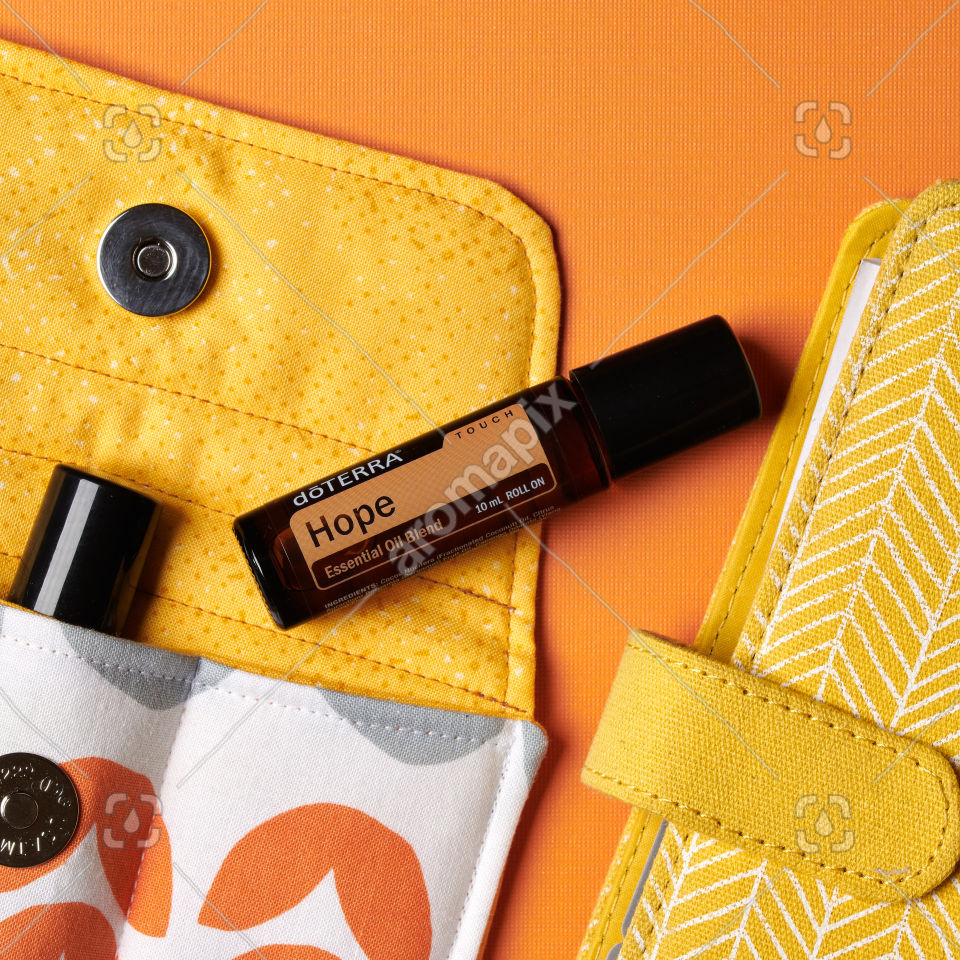 doTERRA Hope Touch with accessories on orange
