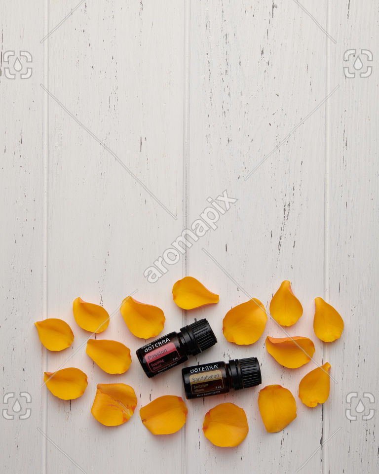 doTERRA Passion and Sandalwood with rose petals on white