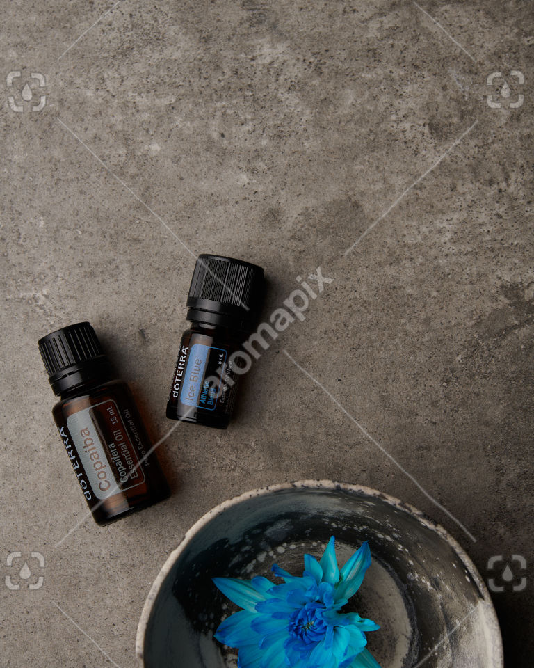 doTERRA Copaiba and Ice Blue on gray