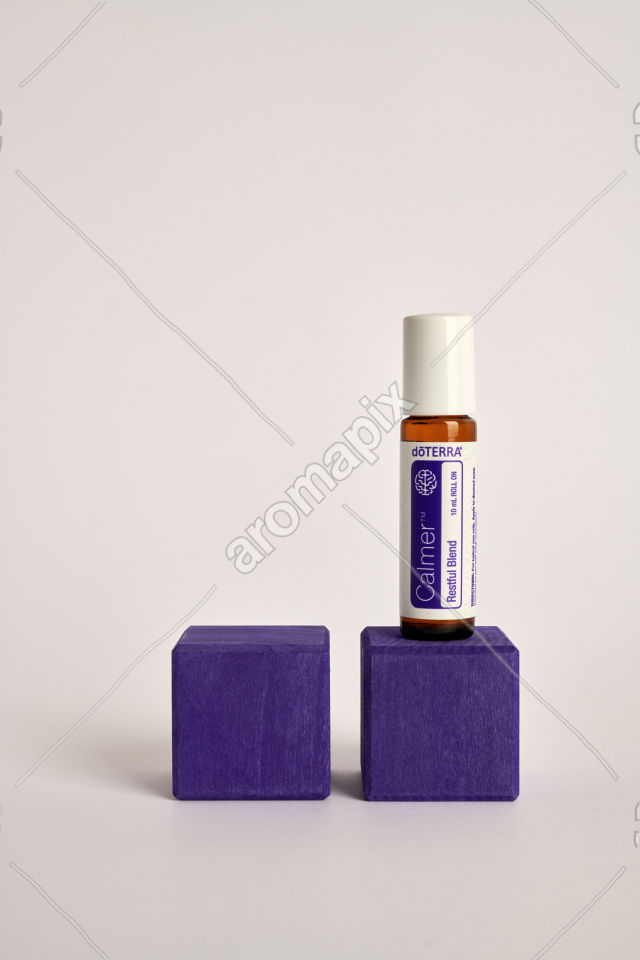 doTERRA Kids Oil Collection Calmer on a wood block