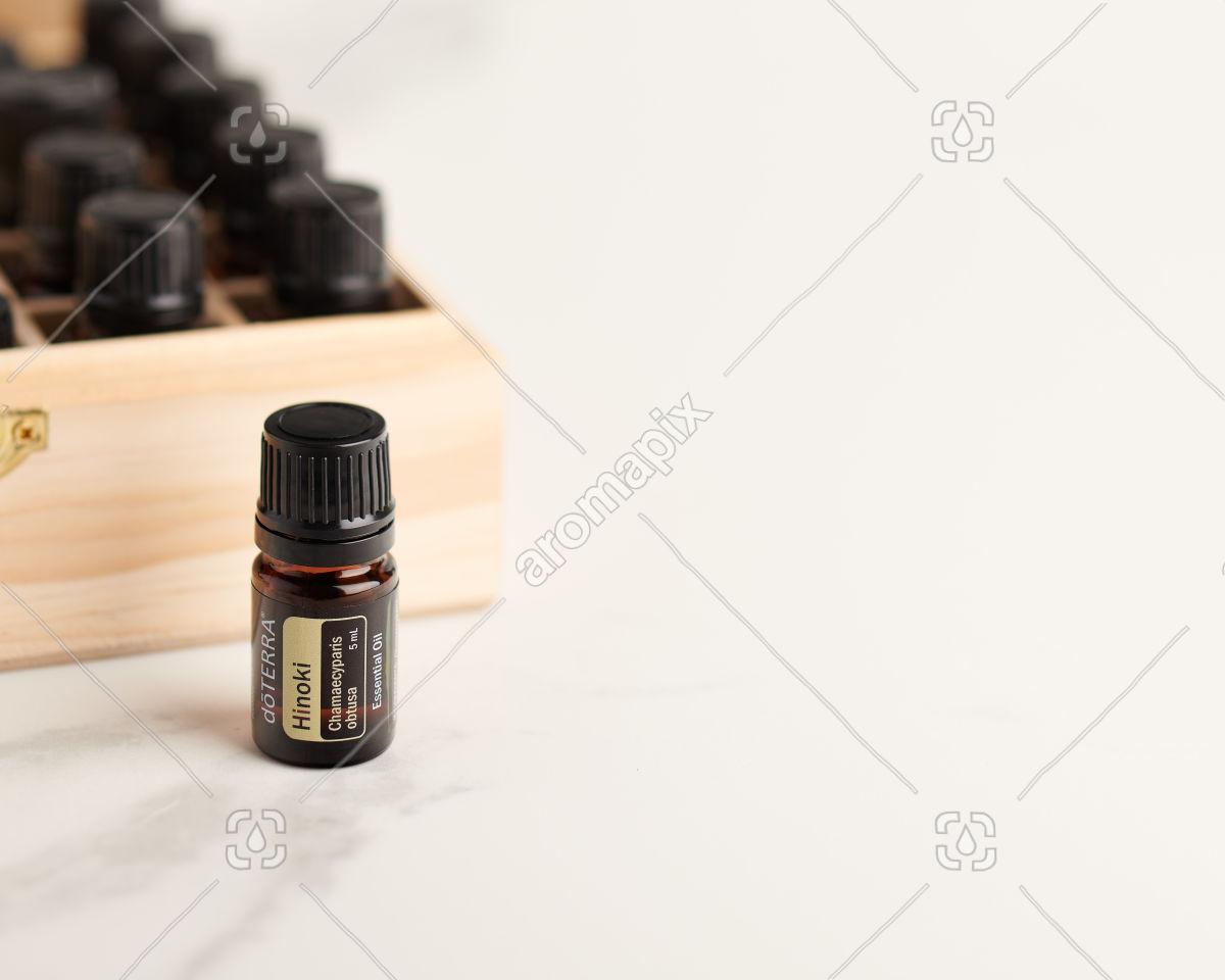 doTERRA Hinoki and essential oil box on white