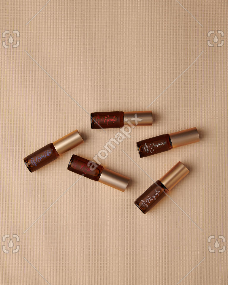doTERRA Neroli Touch, Jasmine Touch, Rose Touch, Magnolia Touch and Blue Lotus Touch on tan linen