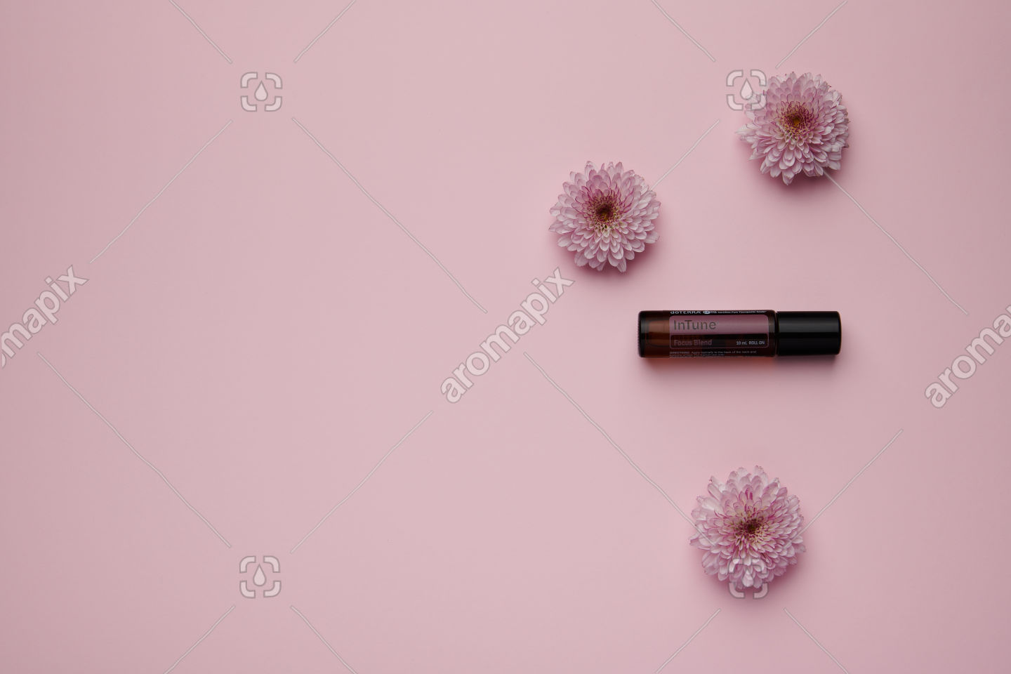 doTERRA InTune with flowers on pink