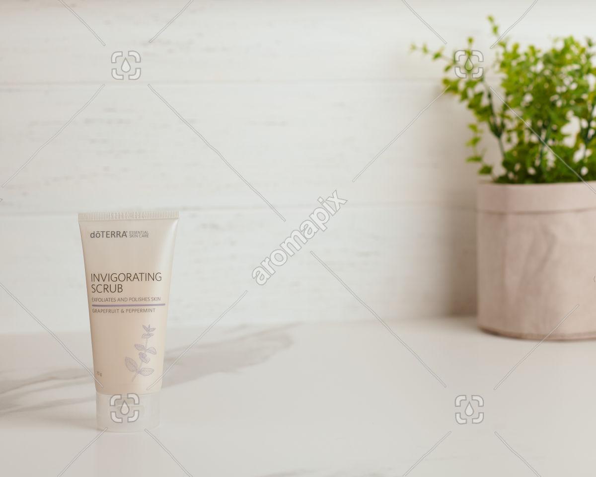 doTERRA Essential Skin Care Invigorating Scrub on white marble bench