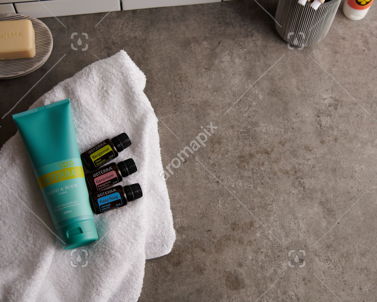 doTERRA Spa Hand and Body Lotion with Bergamot, Geranium and Ylang Ylang essential oils on white