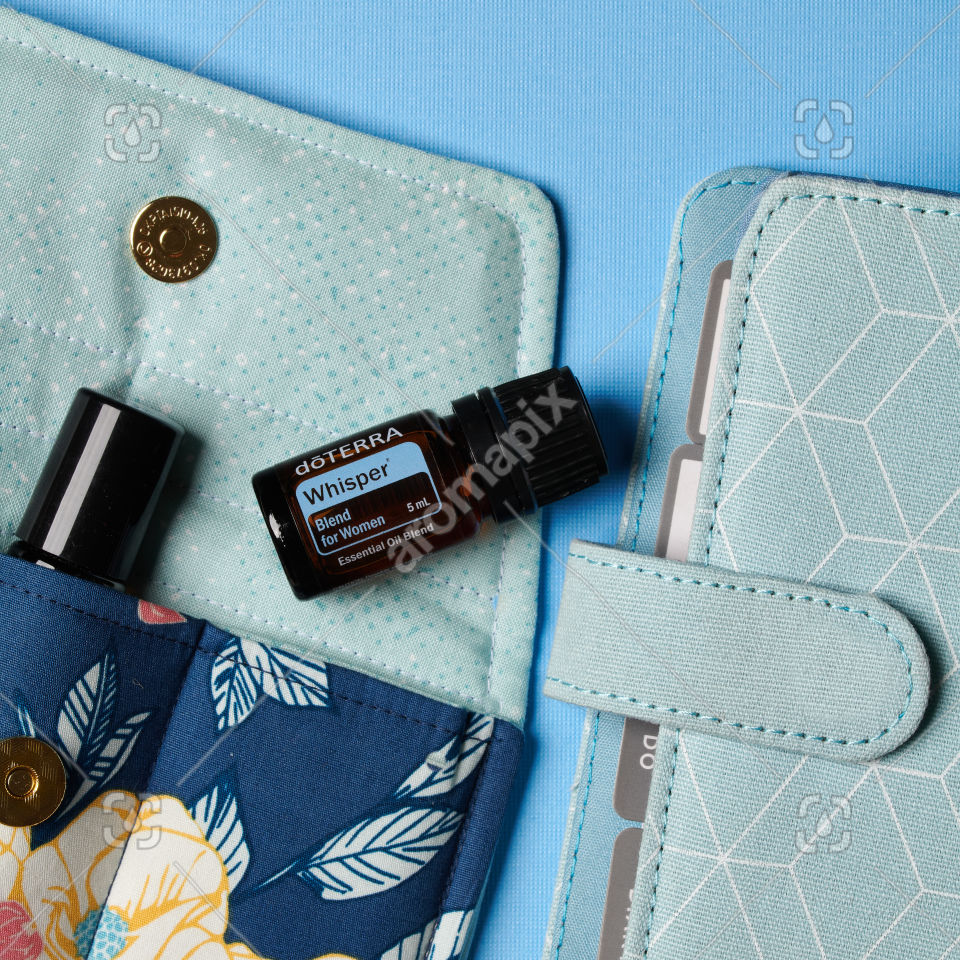 doTERRA Whisper with accessories on blue