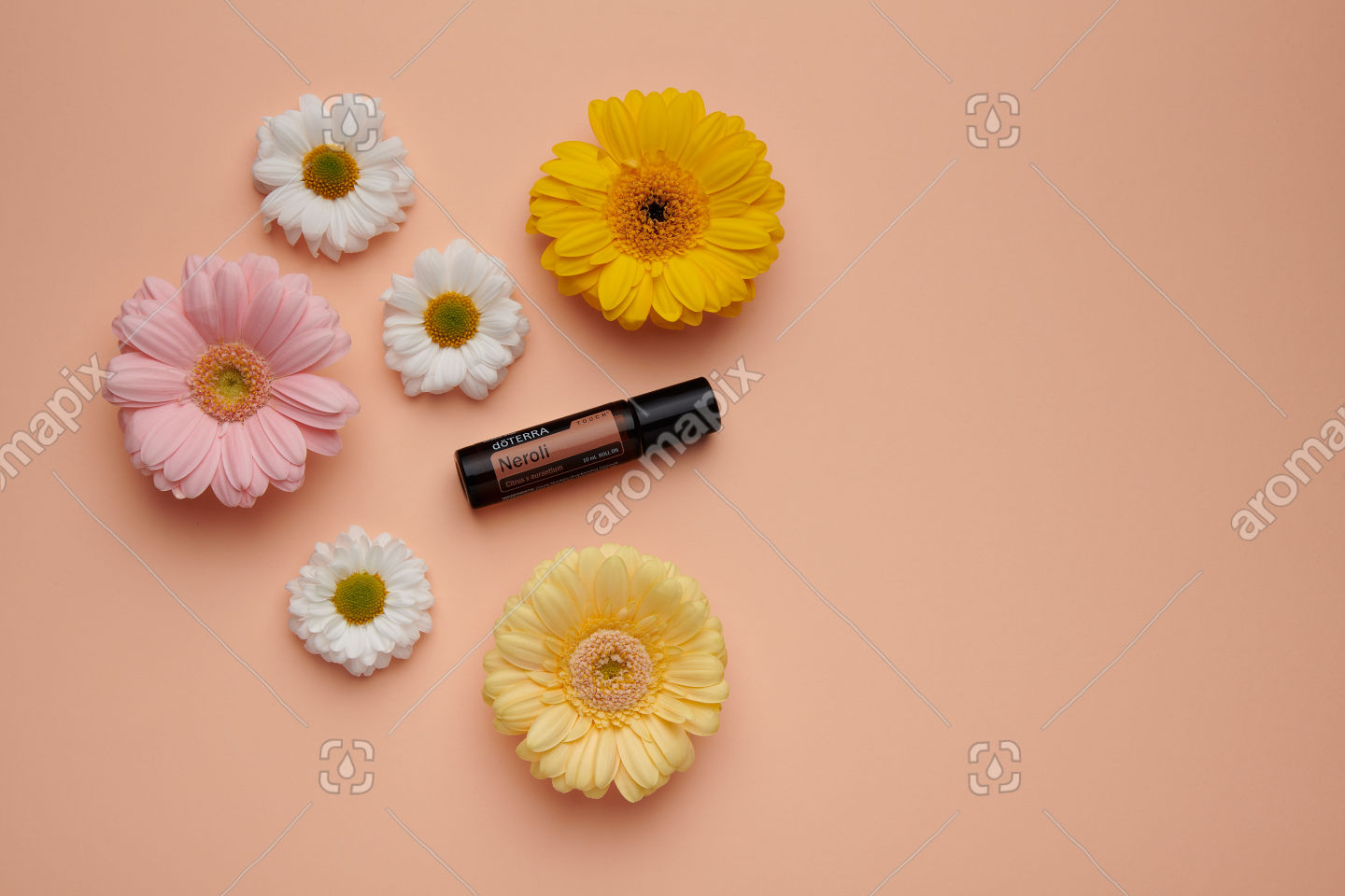 doTERRA Neroli Touch with flowers on pale orange