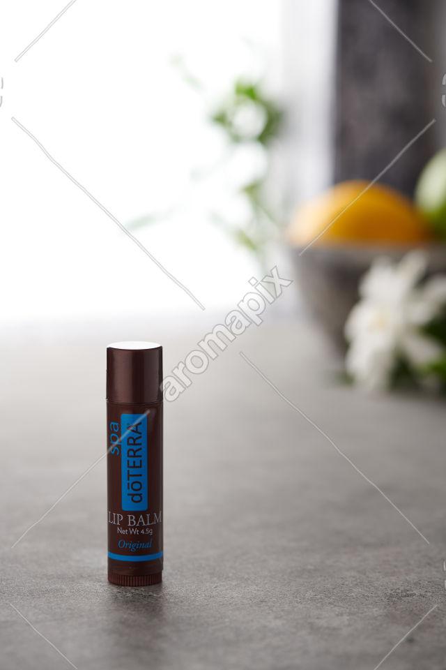 doTERRA Original Lip Balm on a bench
