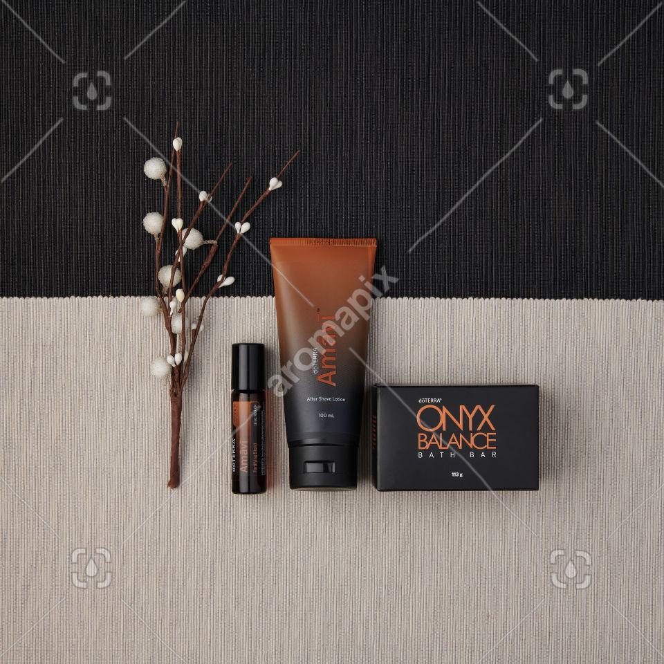 doTERRA Amavi Touch, Amavi After Shave Lotion and Onyx Balance Bath Bar on a dark and light gray backround