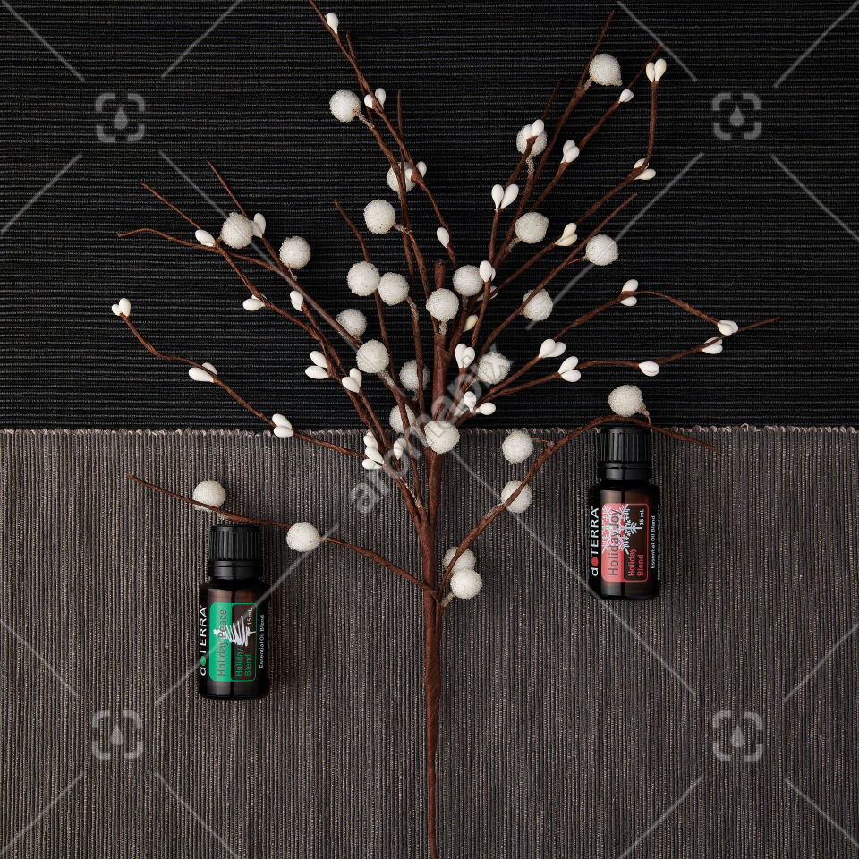 doTERRA Holiday Peace and Holiday Joy with holiday decorations on a textured background