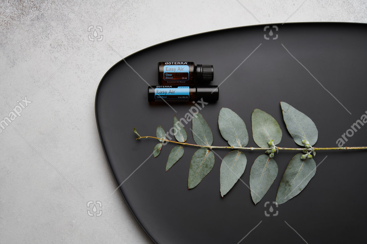 doTERRA Easy Air, Easy Air Touch and eucalyptus leaves on black plate