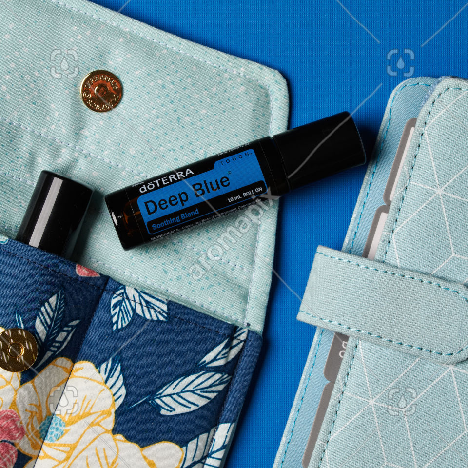 doTERRA Deep Blue Touch with accessories on blue