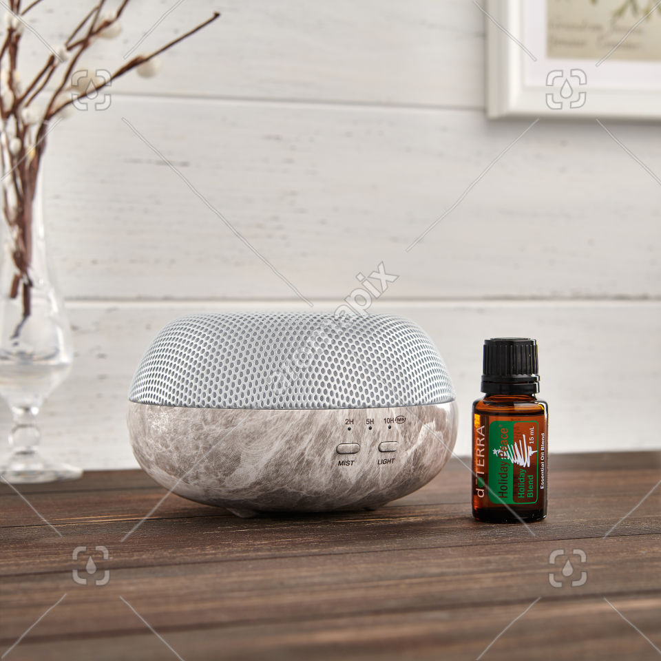 doTERRA Brevi Stone Diffuser and Holiday Joy on a table