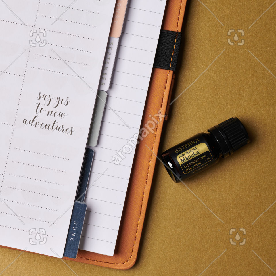 doTERRA Manuka essential oil and a journal