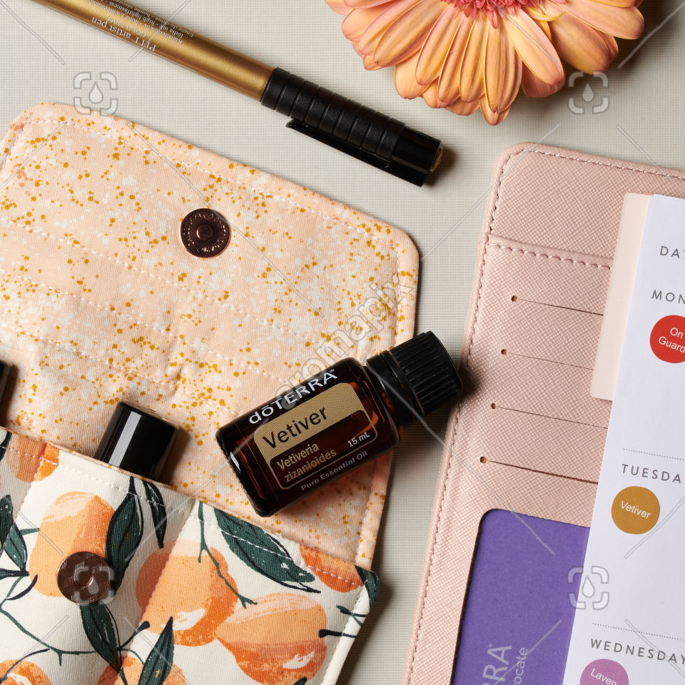 doTERRA Vetiver essential oil and accessories on white