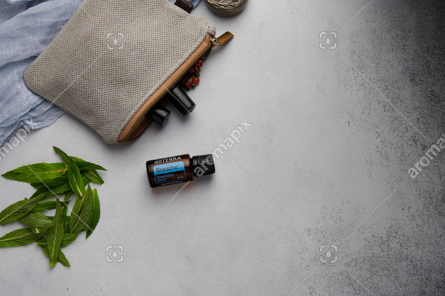 doTERRA Breathe with mint leaves on white