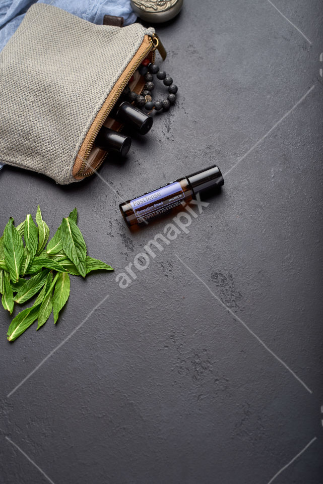 doTERRA PastTense with mint leaves on black