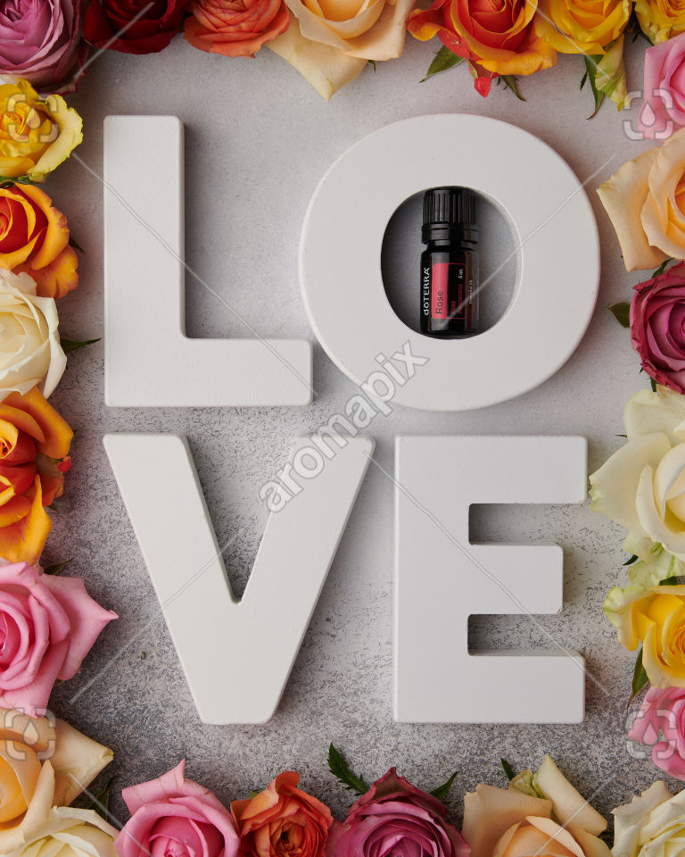 doTERRA Rose with L O V E letters on white